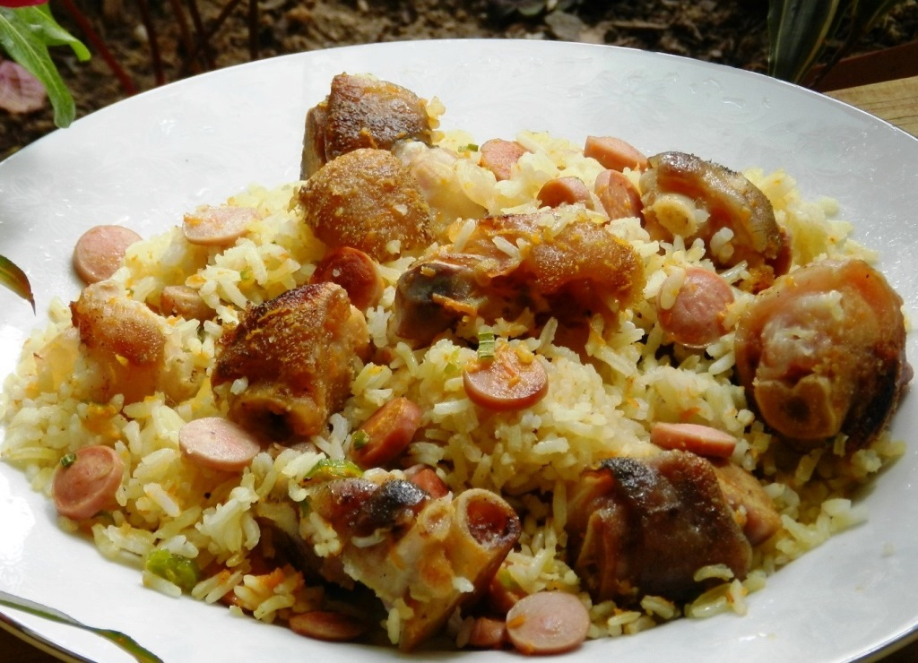 Arroz con paticas de cochino
